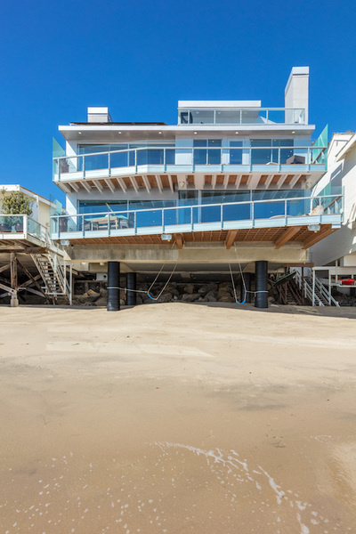 This four-bedroom, beachfront home owned by hotel heir and philanthropist Steven Hilton was recently