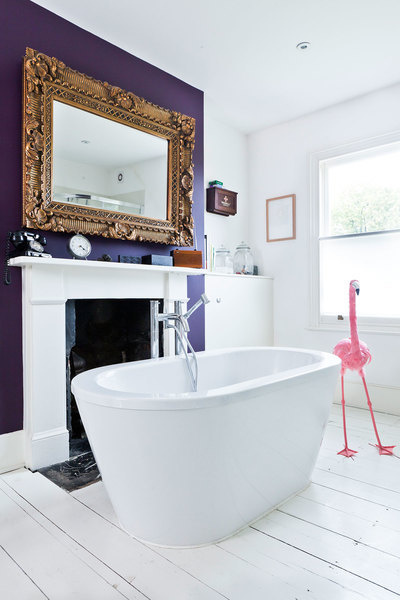 A bathroom is a perfect place to experiment with color as seen here with this ultra violet accent wal