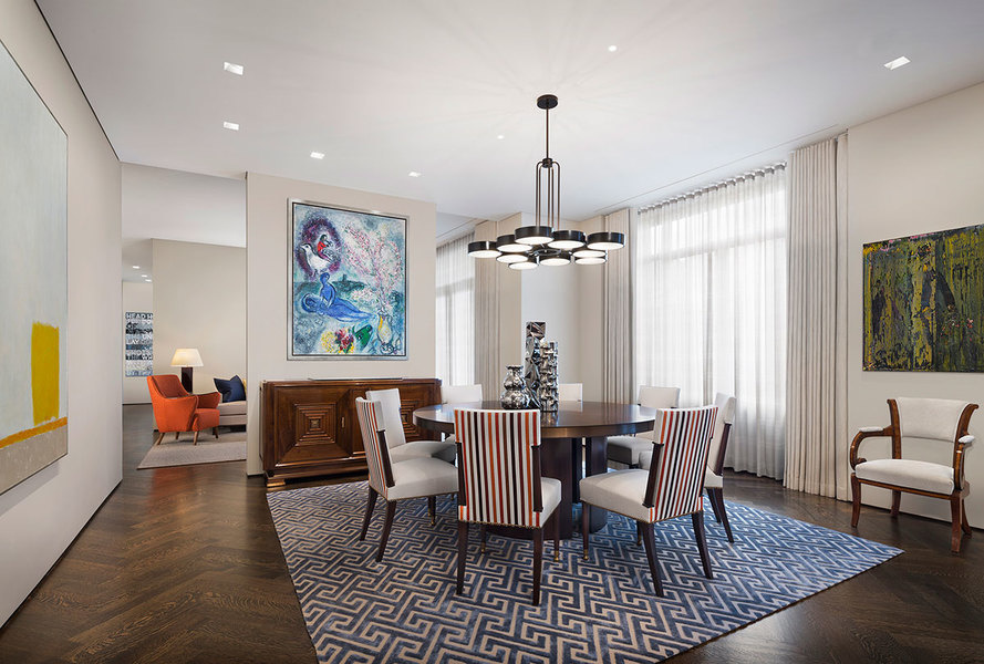 A modern fixture becomes the unique focal point in a modern dining room designed by Eric Cohler.