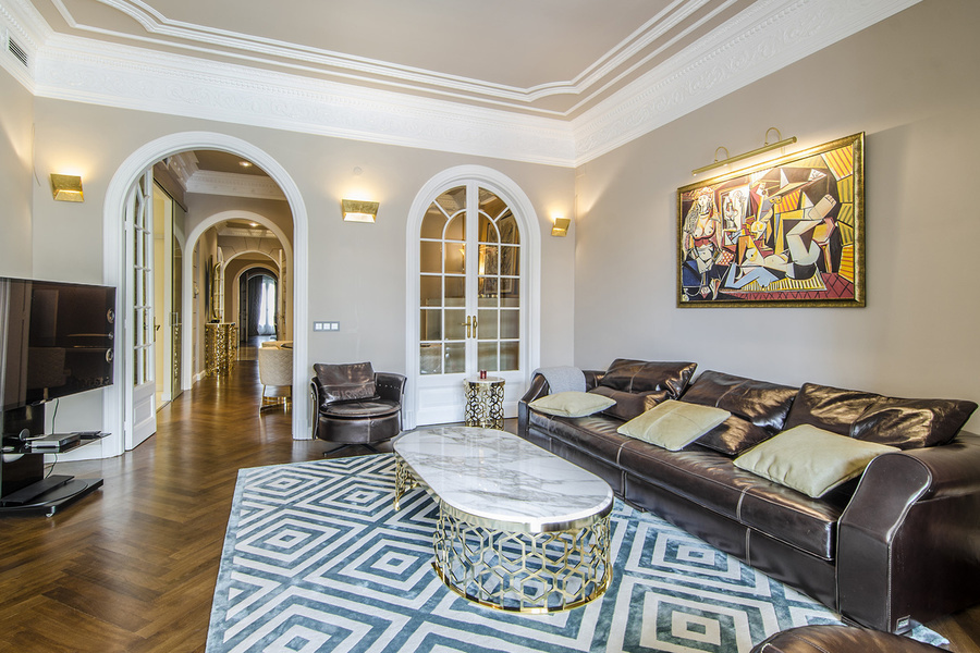 This three-bedroom, two bathroom apartment in a restored building of Eixample district is listed for