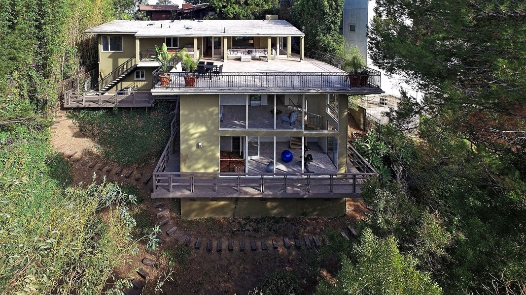 The 1,000-square-foot deck int his four-bedroom offers sweeping views of Griffith Park.