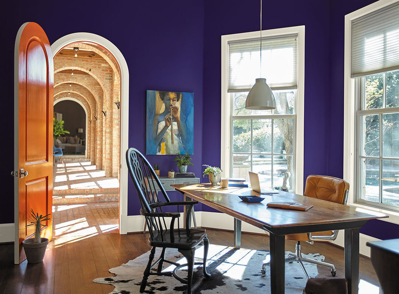 Behr paint in King's Court, an ultra violet shade, brings the walls of this office to live.