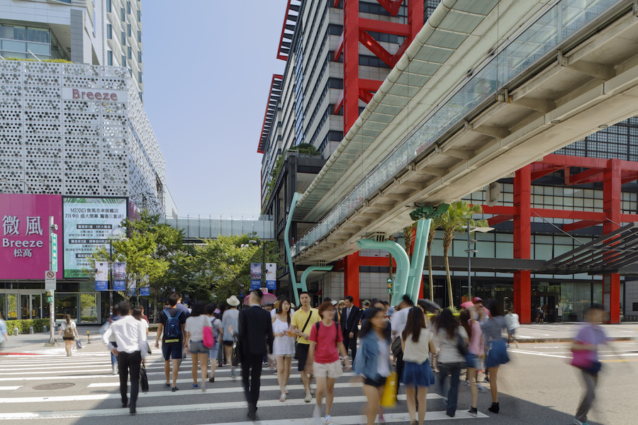 A busy city center crosswalk in Xinyi District, Taipei, Taiwan.