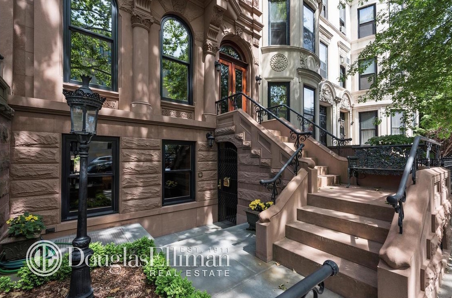 This five-bedroom brownstone house with original architectural details located in Park Slope is liste