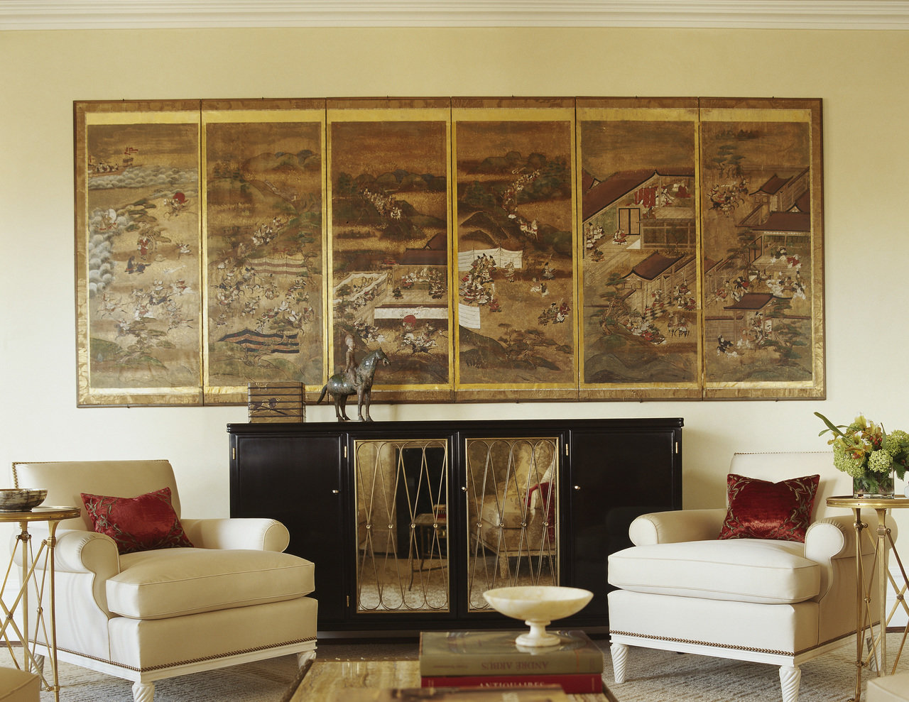Eastern artwork and objects blend with more traditional furniture and modern accents thanks to a limi