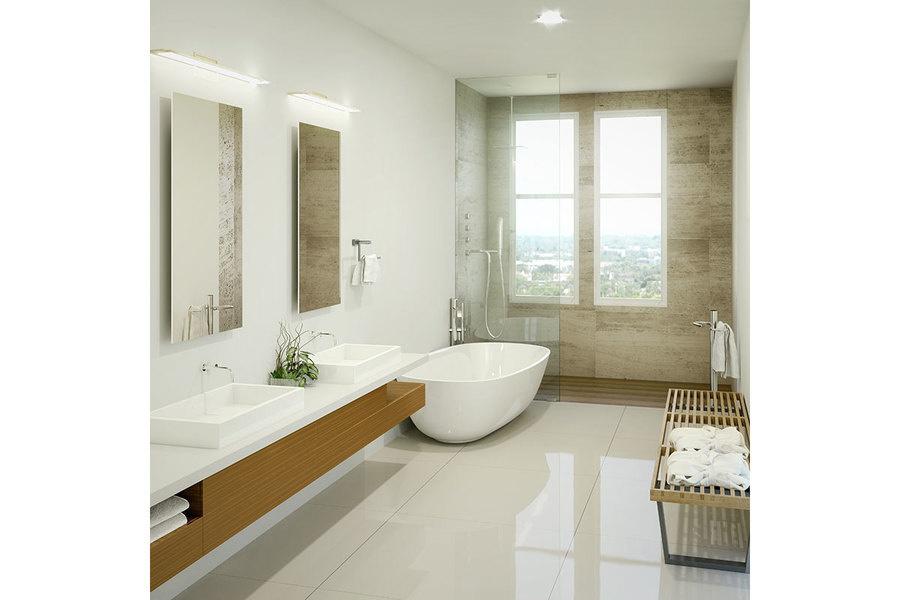 Un baño principal inspirado en un spa incluye piedra importada de Europa y una tina independiente.