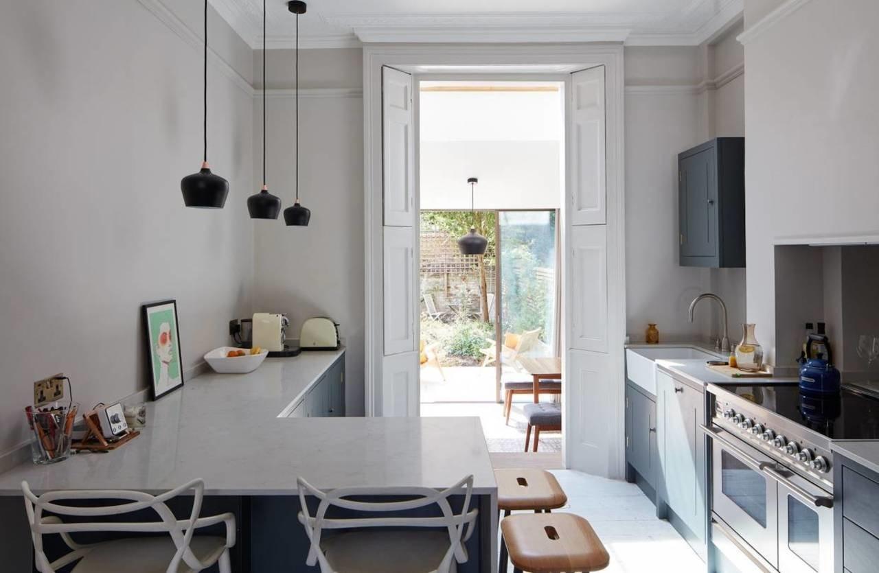 The kitchen, with its white quartzite countertops.
