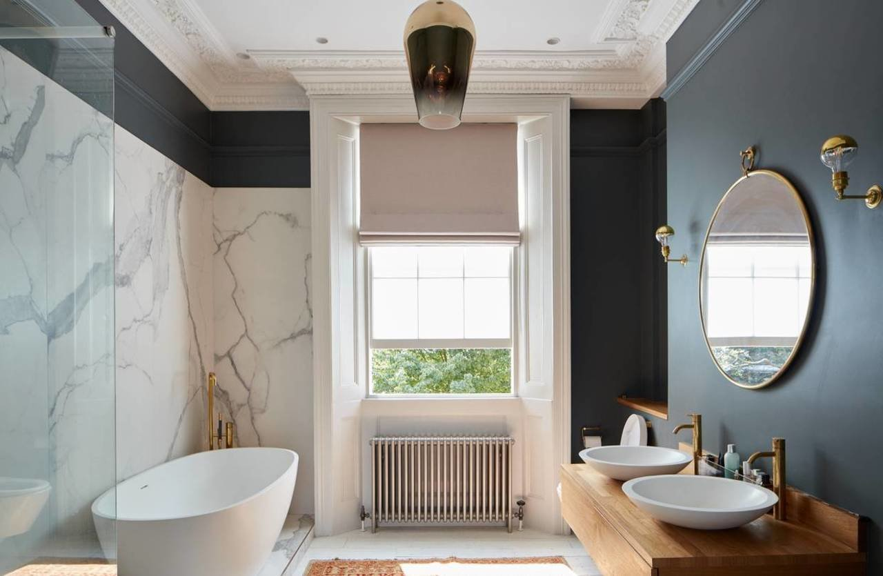 The dramatic master bathroom features a free-standing tub.
